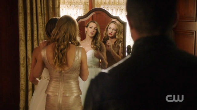 Sara and Laurel in their wedding outfits in the mirror m.