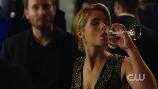 Felicity downing a glass of wine