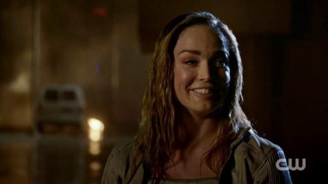 Rain-drenched Sara looks very happy.
