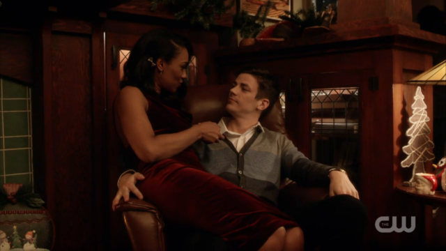Iris sits on Barry's lap