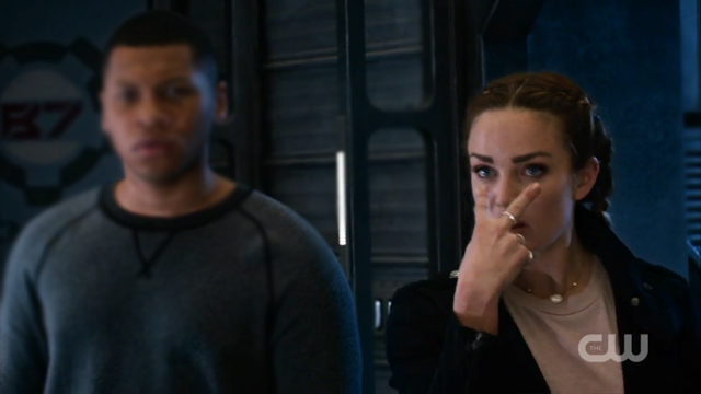 "Sara Lance pointing at her eyes in an ""I'm watching you"" gesture"