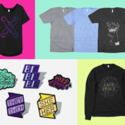 Holigays Merch! Black Scissoring Tee, You Do You Shirts in Heather Grey and Blue, Queer Deer Tee, Enamel Pins (High Femme, Bi Bi Bi, Hard Femme, They/Them and She/Her Pronoun Pins) and the Safe Space Black Fleece Sweater!