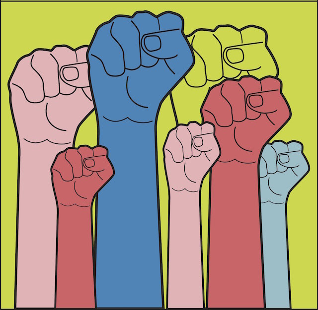 fists of different colors raised together