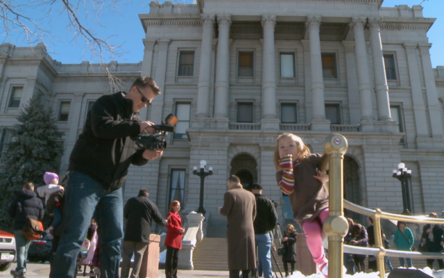 Coy Mathis being filmed outside the courthouse.