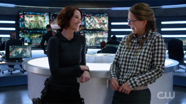 Kara and Alex giggling with each other.