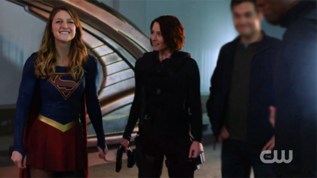 Kara beams while Alex looks on proudly