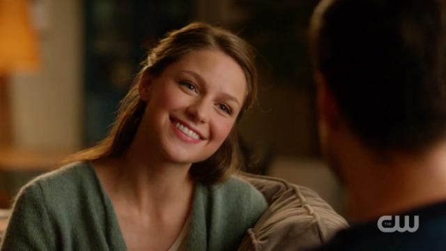 Kara smiles, pleased