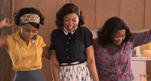 the three main characters from hidden figures smiling and laughing together