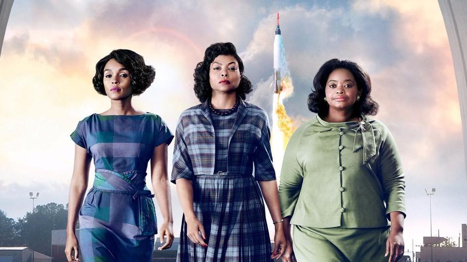 Three black women in front of a rocket. Caption: Janelle Monáe, Taraji P. Henson and Octavia Spencer play Mary Jackson, Katherine Johnson and Dorothy Vaughn, respectively. Via 20th Century Fox.