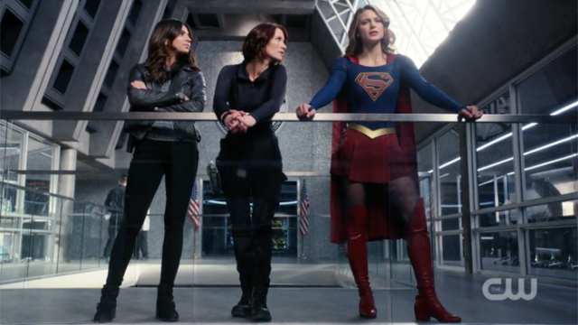 Maggie, Alex and Kara stand side by side by side.