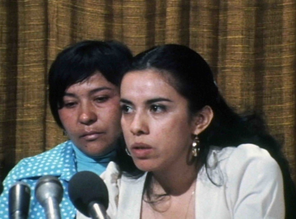 Two women. Dolores Madrigal (left) and attorney Antonia Hernández (right) at a press conference announcing the 1975 lawsuit Madrigal v. Quilligan. NBC Universal Archives, via No Más Bebés.