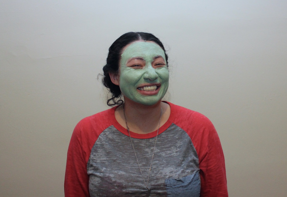 laura with a green face mask on