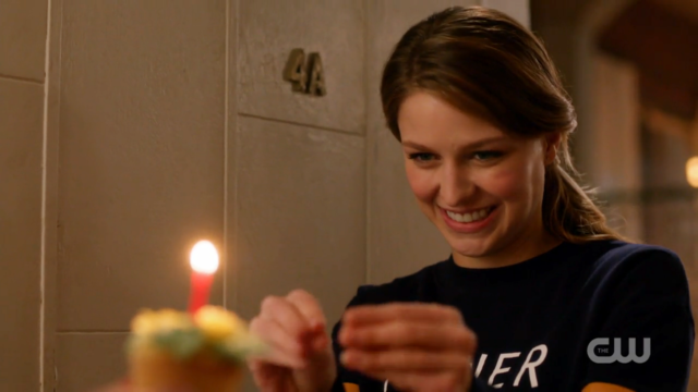 Kara grabby hands the cupcake