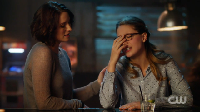 Kara cringes in embarrassment while Alex comforts her