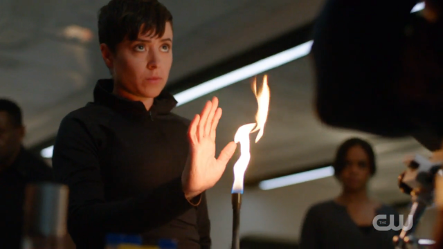 Vasquez puts her hand into the flame