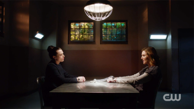 Lena and Lillian sit across the table from one another, not unlike they're playing chess