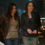 Maggie is smiling and Alex stands next to her, nervous