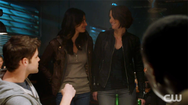 Maggie and Alex smile at each other