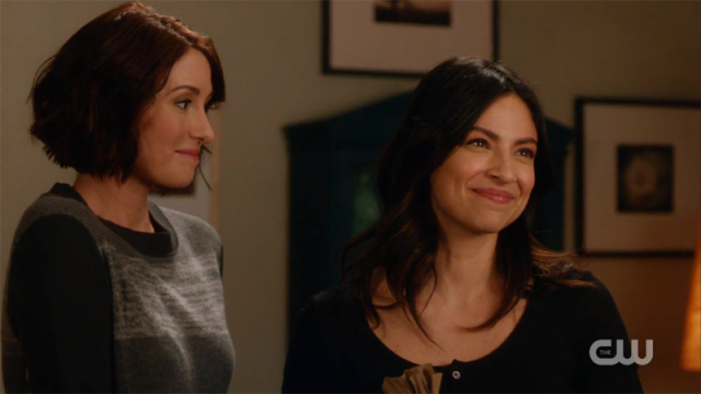 Maggie beams at Jeremiah, Alex looks on lovingly