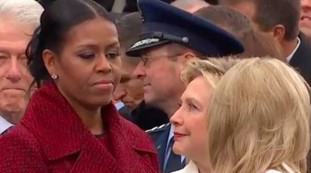 Michelle Obama and Hillary Clinton looking at each other during Trump's inauguration