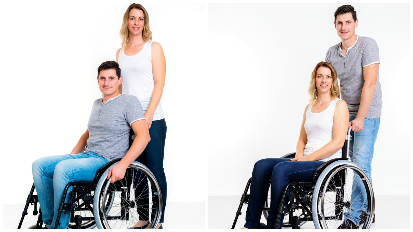 Two photos side by side. On the left, a white blonde woman is standing behind a brunette white man who's sitting in a manual wheelchair. Both are wearing blue jeans; she has a sleeveless white shirt on and he has a grey t-shirt. The right photo is of the same people with their positions switched; now he is standing and she is in the chair.