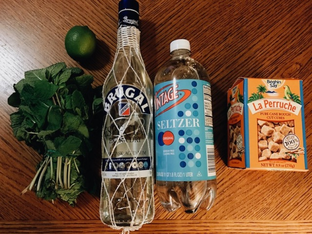 mint, lime, brugal rum, seltzer and sugar cubes