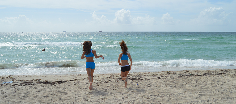 Outplay Swimwear – Shot of girls running into surf