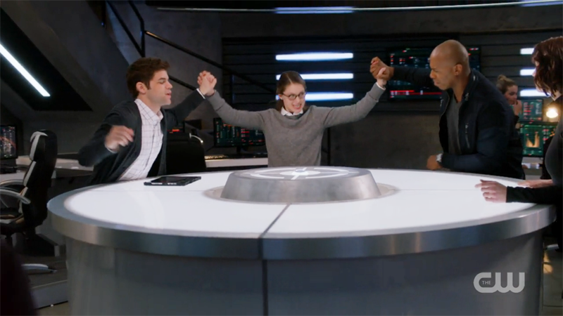 Kara aggressively high fives James and Winn