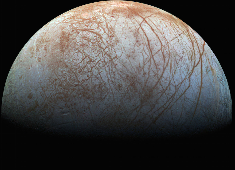 White planet with rusty orange streaks