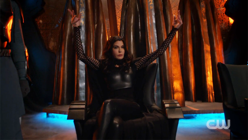 The Queen throws her arms up to command her army