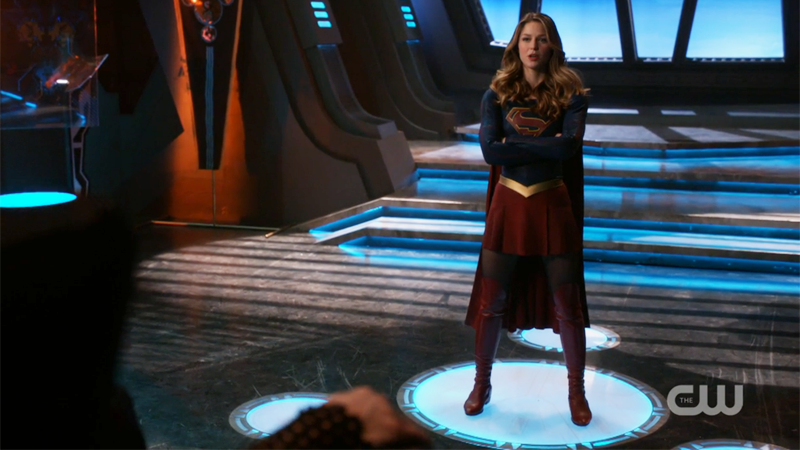 Supergirl stands with her arms crossed