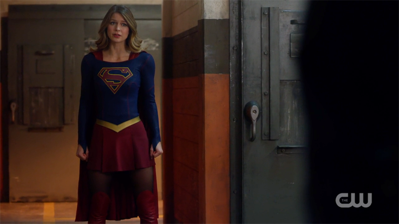 Supergirl stands tall and firm