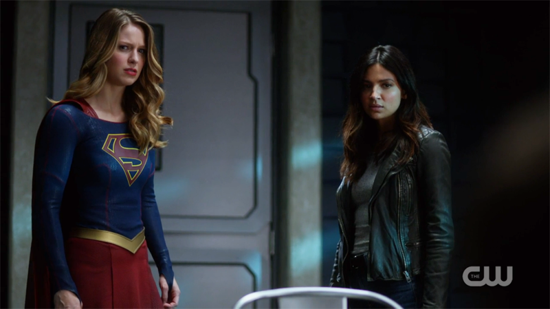 Supergirl and Maggie look worriedly back at Rick