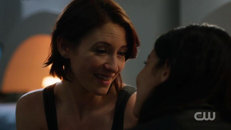 Alex smiles at Maggie