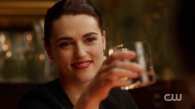 Lena toasts with whiskey