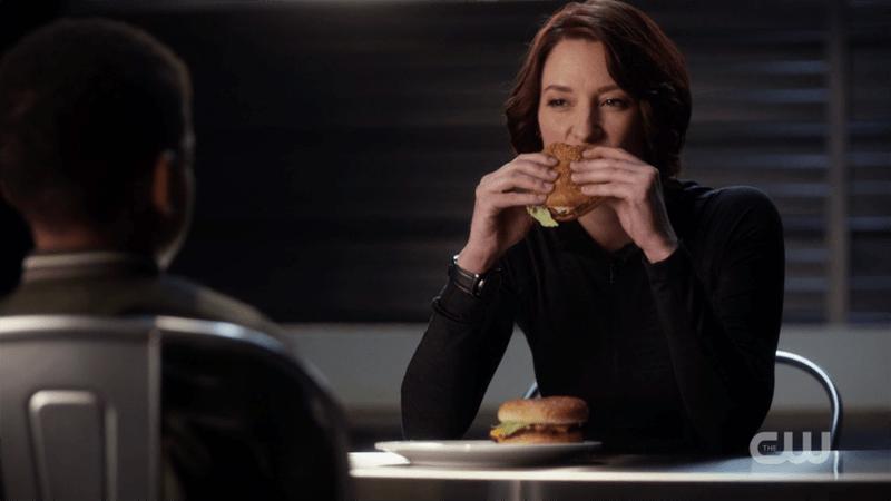 Alex eats a hamburger