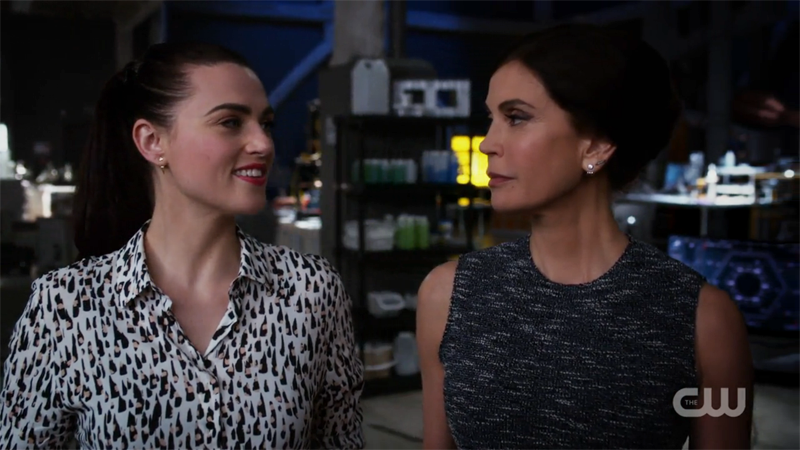 lena and rhea look at each other, pleased