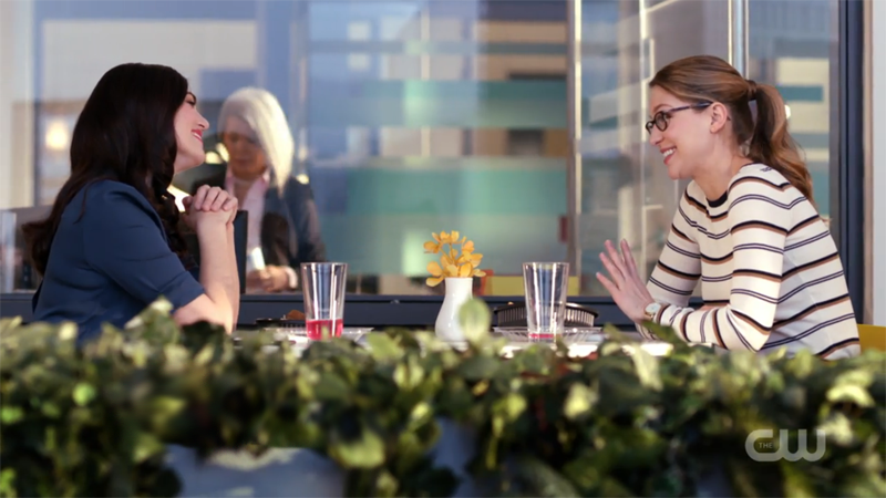 Kara and Lena gaze lovingly at each other from across the table