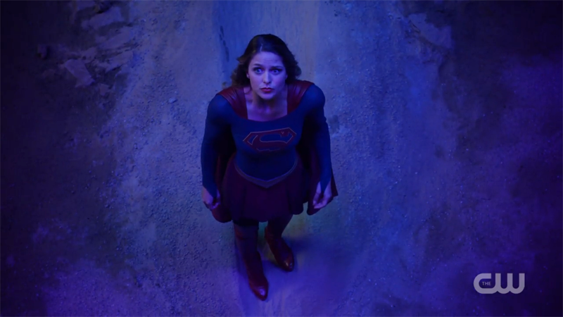 Supergirl looks up at the sky helplessly