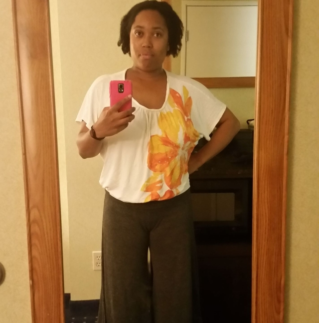 Michon Neal takes a mirror selfie with a hot pink phone.