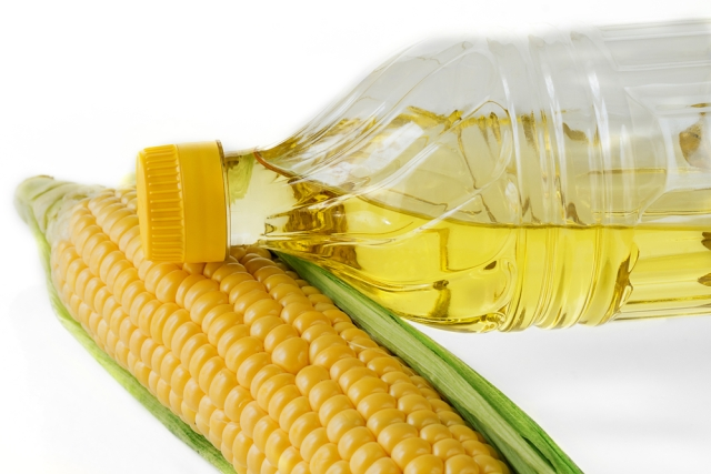 a [suggestive] ear of corn and a bottle of vegetable oil