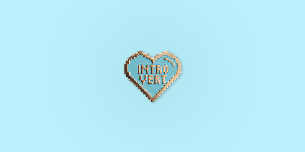 Introvert Enamel Pin / Description: 8-bit heart of rose gold with blue enamel.