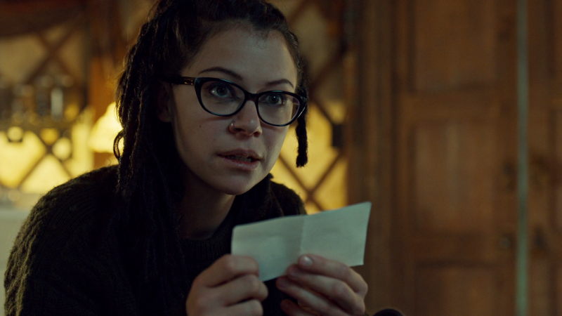 Cosima holds a wee piece of paper