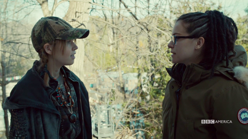 Mud does her cult smile while Cosima regards her questioningly