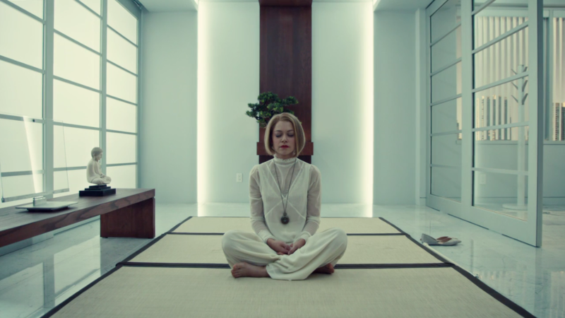 Rachel sits in her white outfit on her white rug in her white room and meditates whitely.