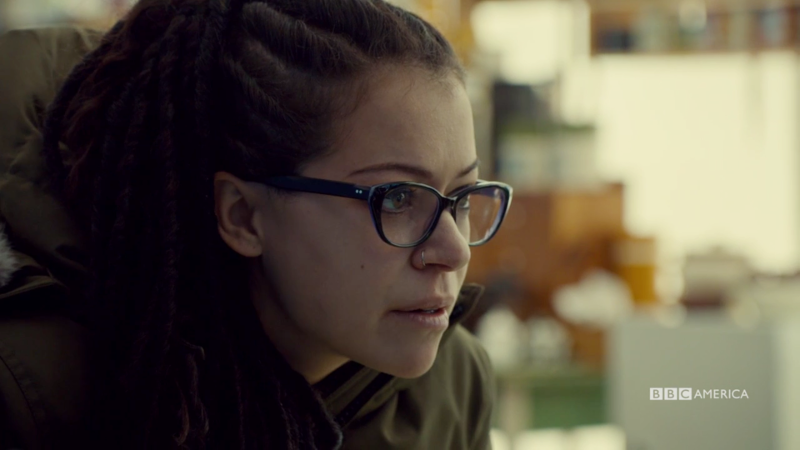 Cosima leans in to ask Chalrotte for help