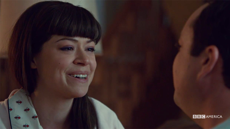 Alison smiles sadly while she sings to Donnie