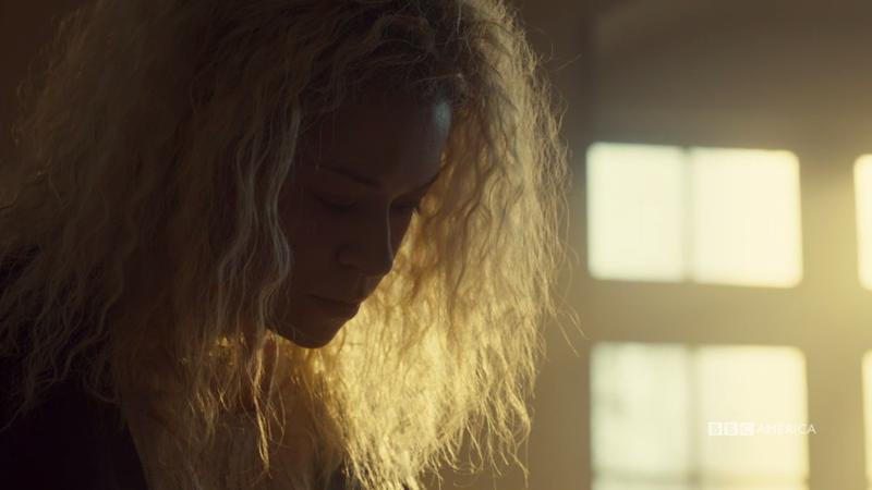 Helena's hair glows like a halo as she writes in her journal