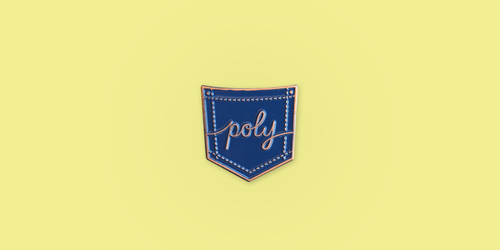 """Poly Enamel Pin / Description: Pocket shape with stitching, """"poly"""" written in script in the center / Metal: Copper / Enamel Color: Navy"""