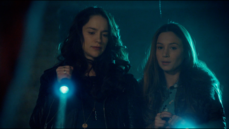 Wynonna and Waverly look...not surprised but surely not pleased upon finding the hellmouth and dead stupid earl